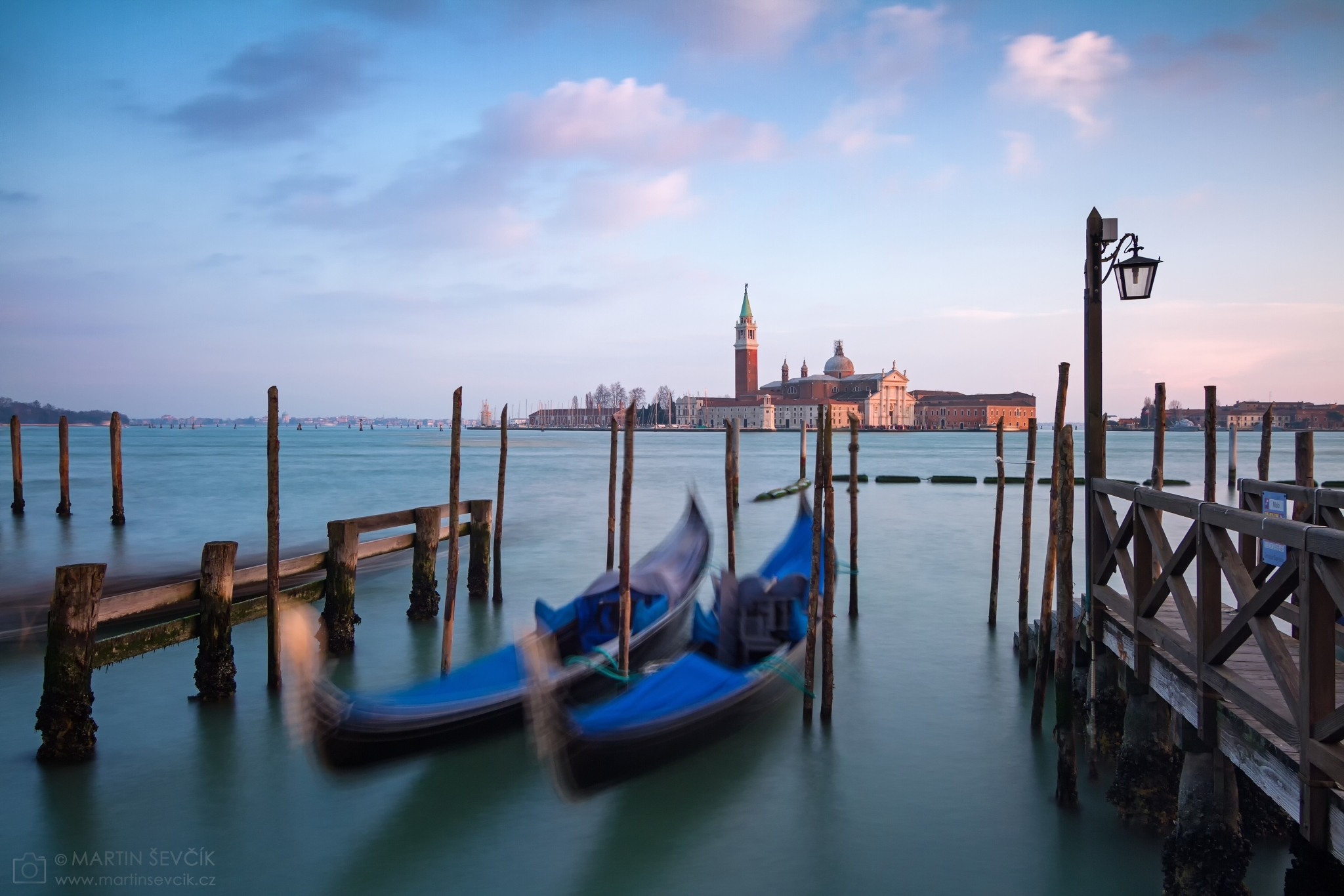 Rocking the Venetian gondolas on the Grand Canal against San Giorgio Maggiore Church